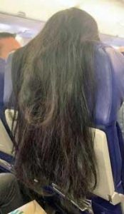Hair Over Airplane Seat